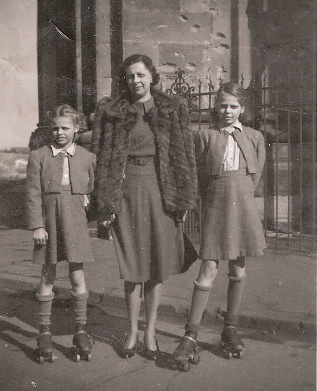 My mother, grandmother, and aunt, forever displaced from their Hungarian estate; Trier, Germany 1945. Note mortal shell damage on background building.